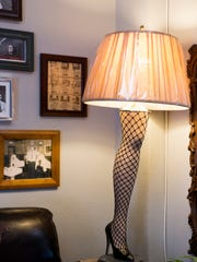 Antique decor, magazines, posters and quirky lamps