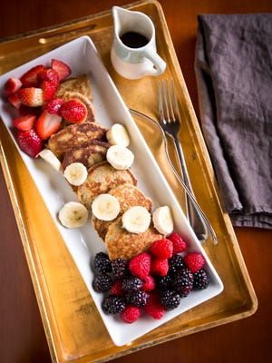 Oat, Banana and Chia Silver Dollar pancakes served with berries and maple syrup.