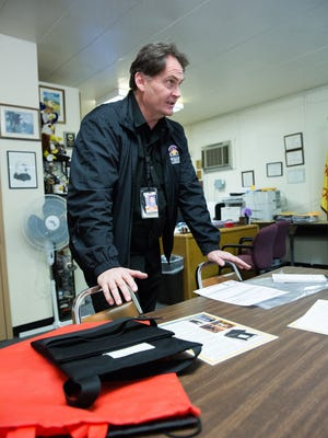 Todd Gregory, head of the security department of Las Cruces Public Schools, demonstrates how the Carry on Shield, is used to protect against gun fire and stabbing attacks. Friday February 17, 2017.