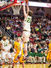 Iowa City West High's (22)Patrick McCaffery goes up for a basket against Cedar Rapids Kennedy during their 4A semifinal at the Iowa boys' high school basketball tournament Friday March 10, 2017, at Wells Fargo Arena in Des Moines, Iowa. West defeated Kennedy 61-37.