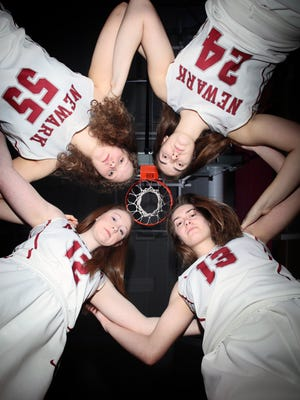 Newark seniors, clockwise from top left, Leah Wingeier, Olivia Fox, Emily Paul, and Carlee Street are undefeated and headed to the state basketball tournament.