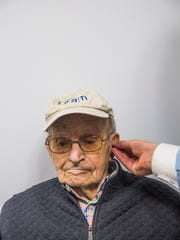 Harry Friedman, 99, of Marco Island receives hearing aids, free of charge, from Life Hearing & Tinnitus Health Centers on Marco Island on Wednesday, March 15, 2017.