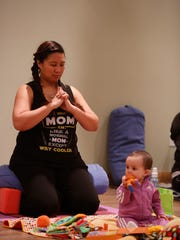 Tina Tiongson of Tarrytown with daughter M.A.Z.zy (cq) at the Mommy and Me Yoga class  at the Riverstone in Tarrytown on Mar. 30, 2017.