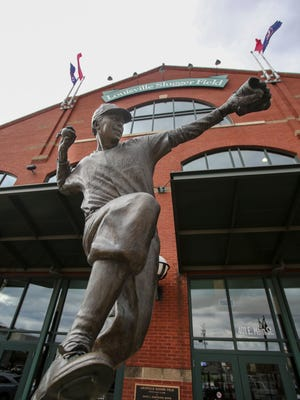 A statue of legendary Pee Wee Reese sits in front of Louisville Slugger Field. April 6, 2017