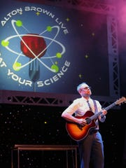 Alton Brown performs at his show, 'Eat Your Science.'