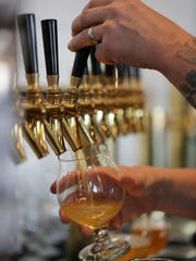 An Axle Brewing Co. beer being poured at the local beer brand's new taproom, Livernois Tap, debuting in Ferndale June 3, 2017.