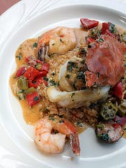 Crab stuffed sole with Creole dirty seafood rice and