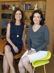 USA TODAY Editor in Chief Joanne Lipman (L) poses for a photo with Facebook COO Sheryl Sandberg at Facebook headquarters in Menlo Park, Calif. on Friday.