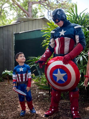 Daniel Barrientos, 5, wears a matching Captain America outfit to visit with superhero Captain America at the Naples Zoo at Caribbean Gardens on Sunday, July 2, 2017. Captain America and Iron Man will be hosting meet and greets at the zoo through the Fourth of July.