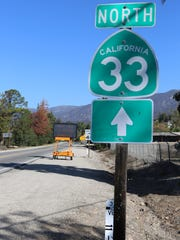 A sign marker on Highway 33.