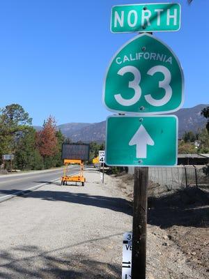 A sign marker on Highway 33.