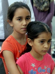 Francesca Cortes, 9, and her sister, Adrianna, 7, daughters