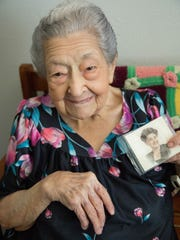 Rose Mackie, a Las Cruces Resident who turned 100 years old in March, holds a photo of her self, Friday, September 15, 2017.