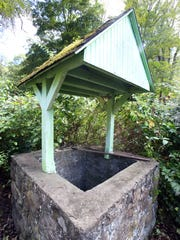 A wishing well on the property of  11 La Shinju St.