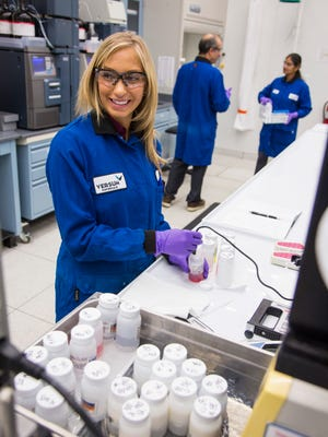 Versum Materials chemists at a quality-control lab in Tempe evaluate material samples for semiconductor manufacturing.