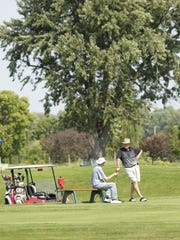 Golfers wait their turn to tee off Sept. 15, 2017,