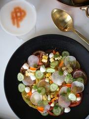 Tomato salad with sweet corn, cucumber, radish and