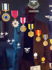 """A board displays Lt. Gen. Robert """"Bob"""" Coverdale's medals Monday, Nov. 6, 2017, at the The Carlisle Naples. Coverdale served 33 years in the U.S. military. He became Vice Commander of the Air Mobility Command, which covered the entire Air Force."""