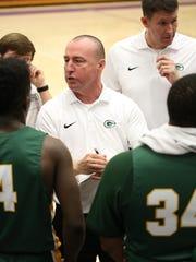 Gallatin High School coach Bobby Luna talks with players