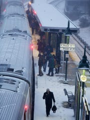 Commuters board a Metro-North train headed to Grand
