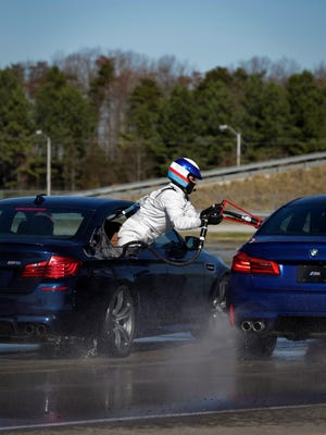 An all-new BMW M5 driven by BMW Performance Center driving instructor Johan Schwartz in refueled mid-drift while setting a new Guinness World Record for the greatest distance vehicle drift in 8 hours at the BMW Performance Driving Center in Greer, SC on Monday, December 11, 2018. Schwartz completed a sustained drift of 232.5 Miles recapturing a record he originally set in 2013.