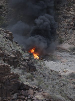 A crashed helicopter burns in a remote section of the Grand Canyon on Feb. 10, 2018.