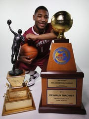 2014 Michigan Mr. Basketball DeShaun Thrower from Muskegon poses with the old and new Mr. Basketball trophies at the Detroit Free Press in Detroit on Monday, March 17, 2014. He hopes to add at Division II basketball title at Ferris State to his resume on Saturday.