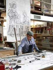 Ramon Hernandez, builds an outline for stained glass