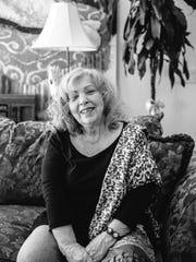 Astrologer Dana Haynes in her home
