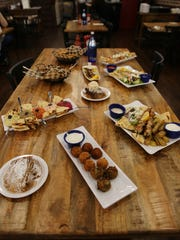 A view of a variety of dishes served at Tzatziki Greek