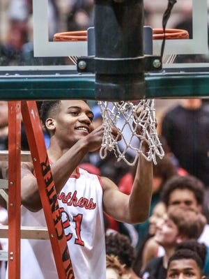 As a North Central player in 2016, Antonio Singleton cut off a piece of the net after his team won the IHSAA Boys Basketball Sectional Tournament over Lawrence Central.