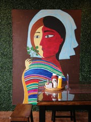 A painting inside Culantro, a new Peruvian restaurant