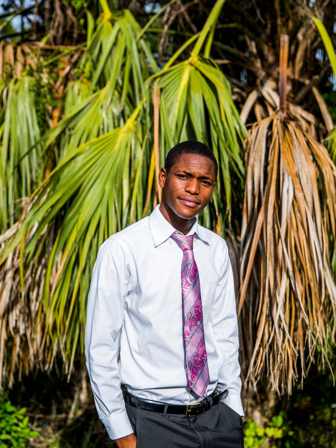 Nehemy Antoine, 19, outside of his East Naples home on Sunday, June 17, 2018. Antoine came to the United States from Haiti with his father when he was 17 years old. He was denied admission to Golden Gate High School when he tried to enroll because he was told that he was too old to finish in a timely manner. Antoine was directed instead to a minimalist GED program run by the district.
