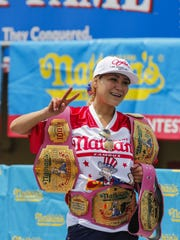 Miki Sudo celebrates after winning the women's annual Nathan's Hot Dog Eating Contest.