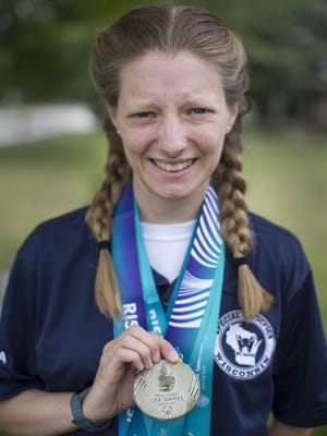 Plymouth's Lora Behr holds her silver medal, Friday, July 27, 2018, in Plymouth, Wis. She earned a silver and other awards during the  2018 Special Olympics USA Games in Seattle, Washington earlier this month. Behr earned a silver in the 200-meter dash, 4th-place finishes in shot put and mini javelin, along with a 5th-place finish in the 100-meter dash.