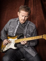 Tim Hawkins integrates music into his comedy act.