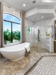 There's no shortage of beautiful and luxurious materials to use in the bathroom.