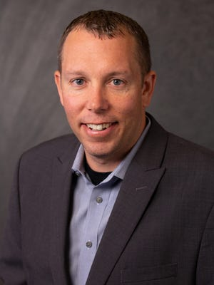 Brett Burgett (pictured) and Bryce Burgett will share the CEO job of their family's construction company, Kokosing.