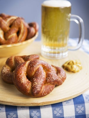 Baking soft pretzels is a great activity for kids and perfect for Super Bowl parties.