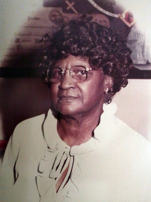 A photo of Talley from her younger days hangs in her living room. She credits God for her longevity.