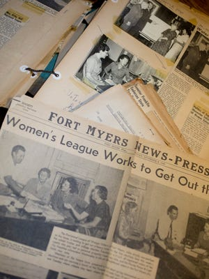 News clippings from a scrapbook of the Lee County Women's League of Voters.