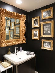 The powder room reminds guests that this home was once occupied by Liberace.