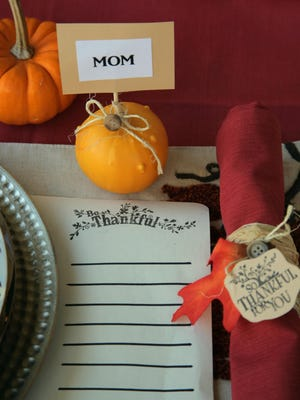 Greet your guests with a thankful place mat that they can write on, a gourd with their name and a napkin ring made out of a paper towel roll.