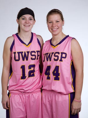 Then-seniors Jenna Pitt, left, and Claire Glodowski found special meaning in the 2014 Play4Kay game as both had family members battling cancer.