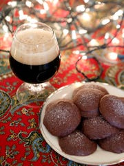 Cookies for the kind of young: Salted dark chocolate cookies and stout are photographed Nov. 18, 2014 in Ridgefield, Conn.