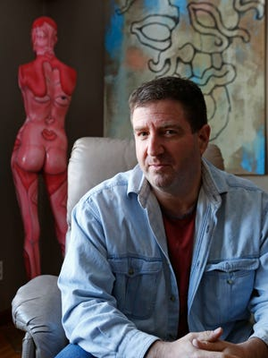 Artist Andy Golub at his home in South Nyack. Last summer, Golub took part in Bodypainting Day, helping to paint 50 nude models in the middle of Times Square. On Jan. 24, Golub, a 1984 Tappan Zee High School graduate, will paint nude models at the Nyack Center and then sit down with Elliott Forrest to talk about art, the law and how he made the progression from painting rocks to painting bodies.