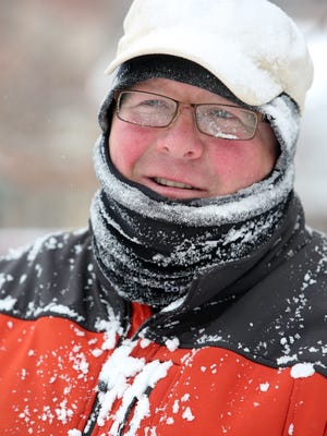 Bob Hayes is covered in snow Tuesday after he used a snow blower to clear a sidewalk in Cold Spring.