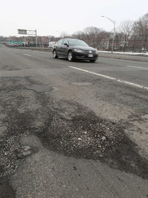 Potholes are seen on March 10 along Central Park Avenue near Arlington Street in Yonkers.
