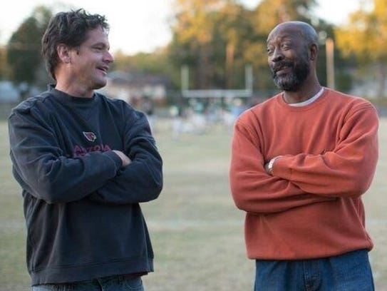"Former Alabama, Dolphins great Tony Nathan visits with Kevin Downes, one the producers of ""Woodlawn."""