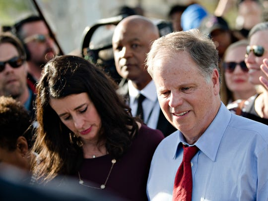 Senator Doug Jones crosses the Edmund Pettus Bridge
